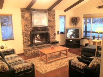 Living Room, with comfortable furnigure, wood burning fireplace, large TV w/Cable-DVR, DVD Player, and Stereo